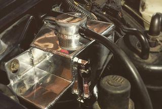 homepage tile photo for Replacement radiator and shiny new coolant overflow tank