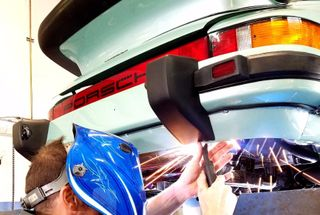 homepage tile photo for Welding on exhaust cap finishing up my 79 930!