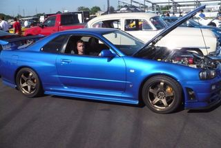 homepage tile photo for Myself sitting in a Bayside Blue R34 at M1 Concourse's Cars and...