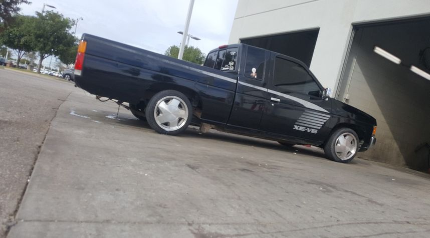 Main photo of Tyler Spear's 1995 Nissan Truck