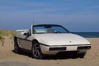 homepage tile photo for 1984 Fiero SC Convertible on the beach in Oscoda, MI