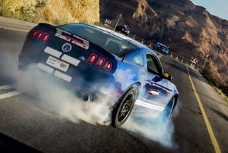 homepage tile photo for Shelby GT500 2013 burning tires