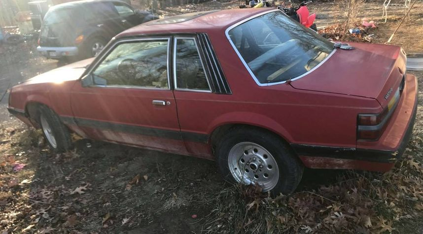 Main photo of Fox Four's 1986 Ford Mustang