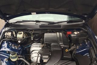 homepage tile photo for Cleaned and polished the engine bay, removed the exhaust heat...